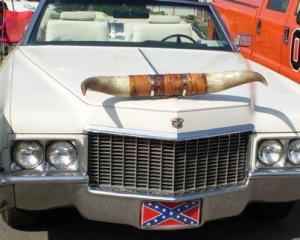 A true texans with a horned adorned cadillac
