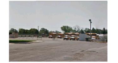 Gated bus yard.